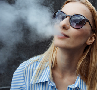 Woman exhaling smoke